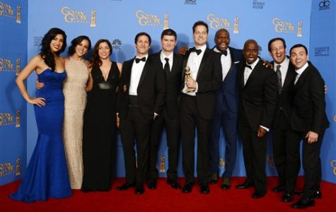 From left, Stephanie Beatriz, Melissa Fumero, Chelsea Peretti, Andy Samberg, Michael Schur, Dan Goor, Terry Crews, Andre Braugher, David Miner and Joe Lo Truglio pose in the press room with the award for best television series - comedy or musical for