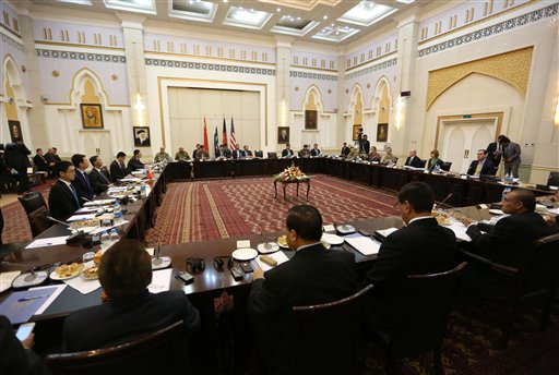 Delegations from Afghanistan, Pakistan, The United States of America and China discuss a road map for ending the war with the Taliban at the Presidential Palace in Kabul, Afghanistan, Tuesday, Feb. 23, 2016. An Afghan official says talks in Kabul between representatives of four countries trying to end Afghanistan's war with the Taliban are likely to set a date for a face-to-face meeting between the two sides. (AP Photo/Rahmat Gul)