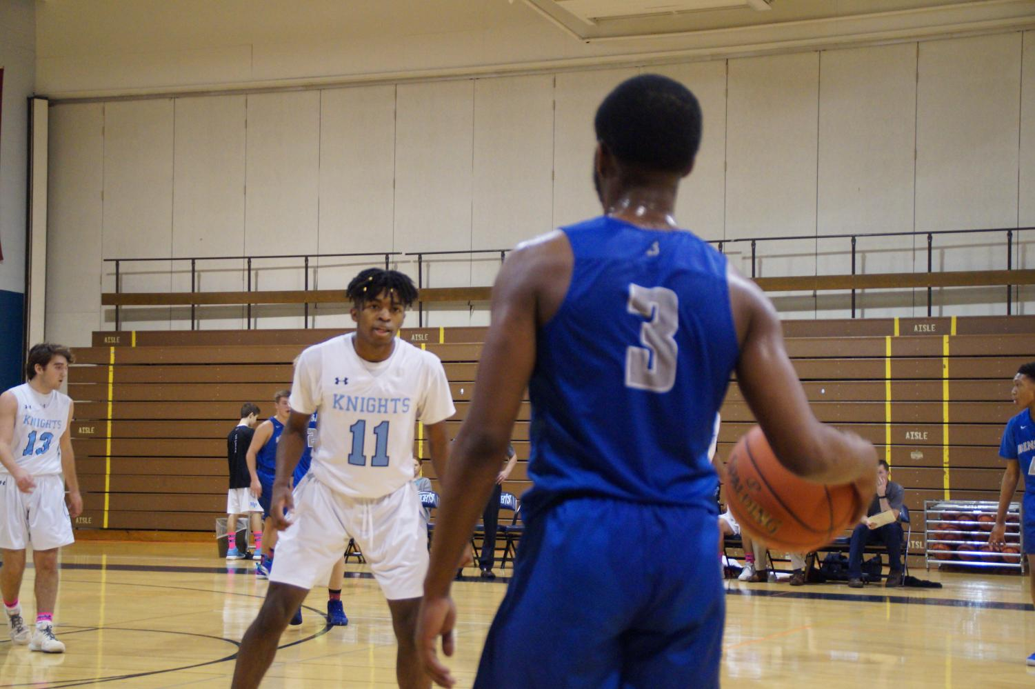 A.J. Mitchell guards Reuben Jean-Phillips
