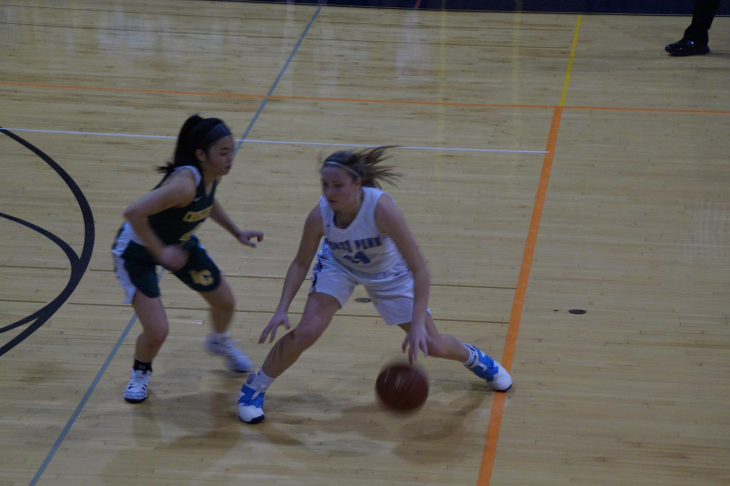 Sophomore Alli Lindsay is defended by Maile Erwin.  Lindsay had 24 points.