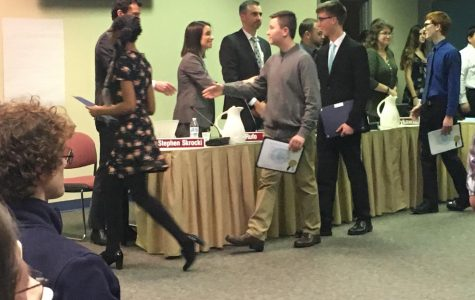 Board recognizes Marching Knights, approves Superintendent's Report