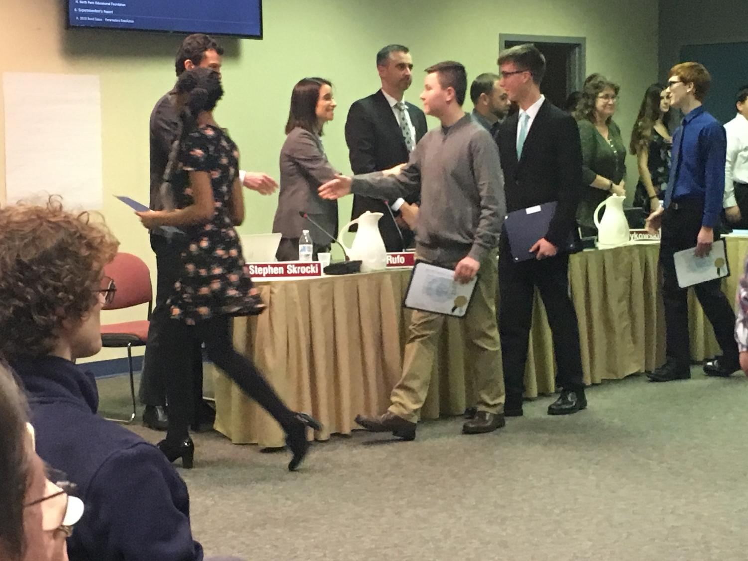 At Thursday's action meeting, the Board recognized members of the NPHS Marching Knights.