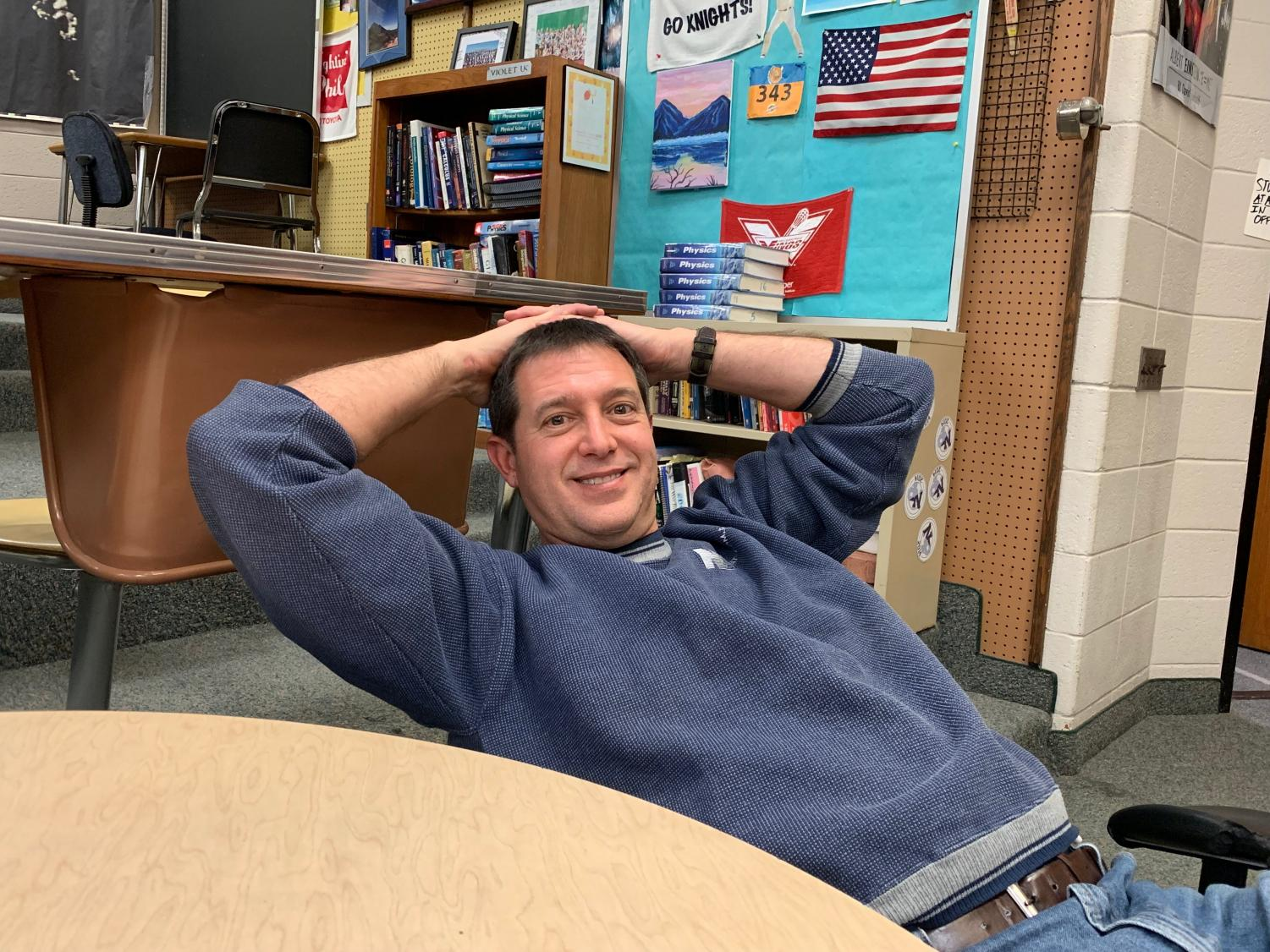 Mr. Young lounging in his classroom, C039.