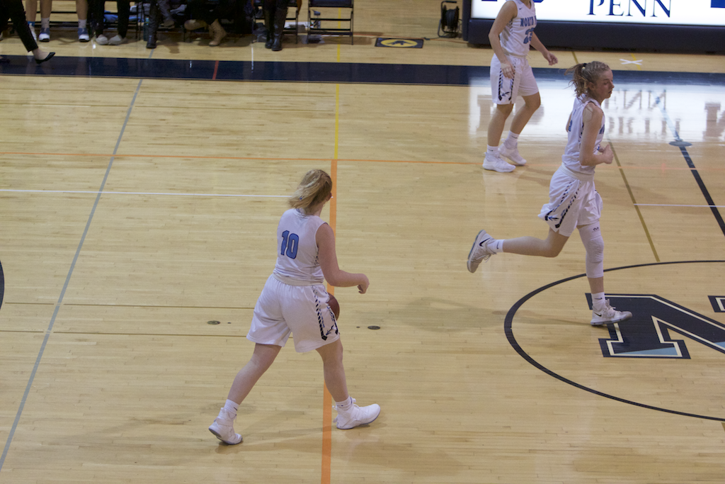Sophomore Laynie Doran dribbles down the court for the Knights.