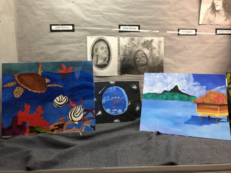 Various types of North Penn art work on display.