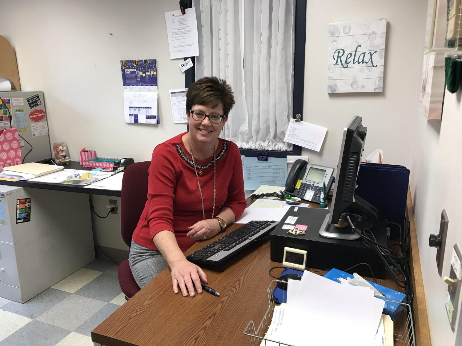 Skillman in her office; the cheerful nurse is eager to assist North Penn students with their medical needs.
