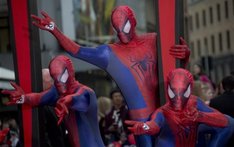 Costumed performers wearing Spiderman costumes, arrive for the World premiere of The Amazing Spiderman 2, at a central London cinema in Leicester Square, Thursday, April 10, 2014. (Photo by Joel Ryan/Invision/AP)
