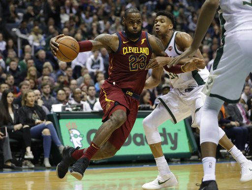 b7ed1083e4b5 Cleveland Cavaliers  LeBron James drives past Milwaukee Bucks  Giannis  Antetokounmpo during the first half