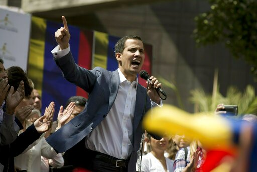 In this Jan. 11, 2019 photo, Juan Guaido, President of the Venezuelan National Assembly delivers a speech during a public session with opposition members, at a street in Caracas, Venezuela. The head of Venezuela's opposition-run congress says that with the nation's backing he's ready to take on Nicolas Maduro's presidential powers and call new elections.(AP Photo/Fernando Llano)