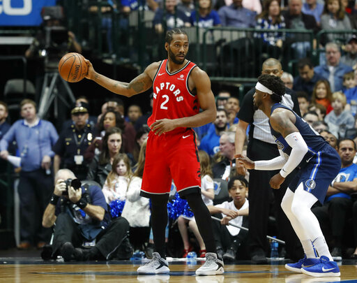 10d5c39916e0 ... Leonard (2) holds the ball against Dallas Mavericks guard Wesley  Matthews (23) during the second half of an NBA basketball game in Dallas