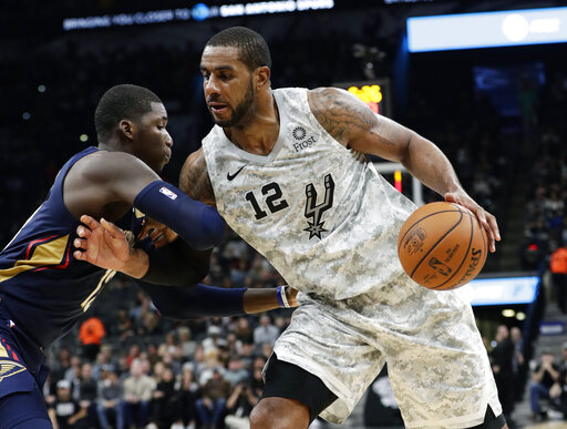 San Antonio Spurs center LaMarcus Aldridge (12) drives around New Orleans  Pelicans forward Cheick Diallo during the second half of an NBA basketball  game in ... e5763fd20