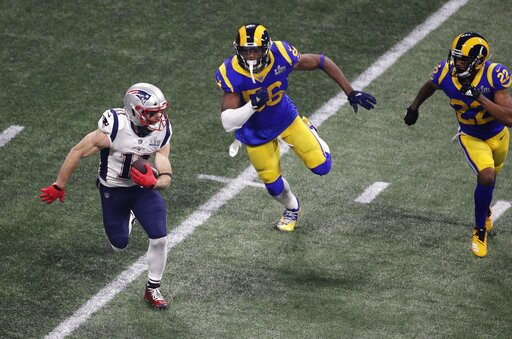 New England Patriots' Julian Edelman (11) runs past Los Angeles Rams' Dante Fowler (56) and Marcus Peters (22) during the second half of the NFL Super Bowl 53 football game Sunday, Feb. 3, 2019, in Atlanta. (AP Photo/Charlie Riedel)