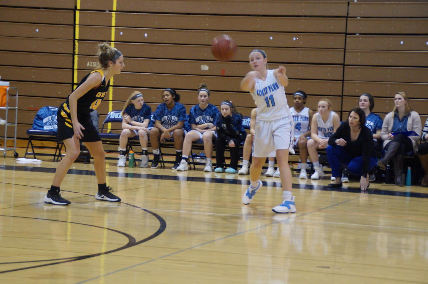 Sophomore Alli Lindsay passes the ball as she creates high percentage shots for her teammates.