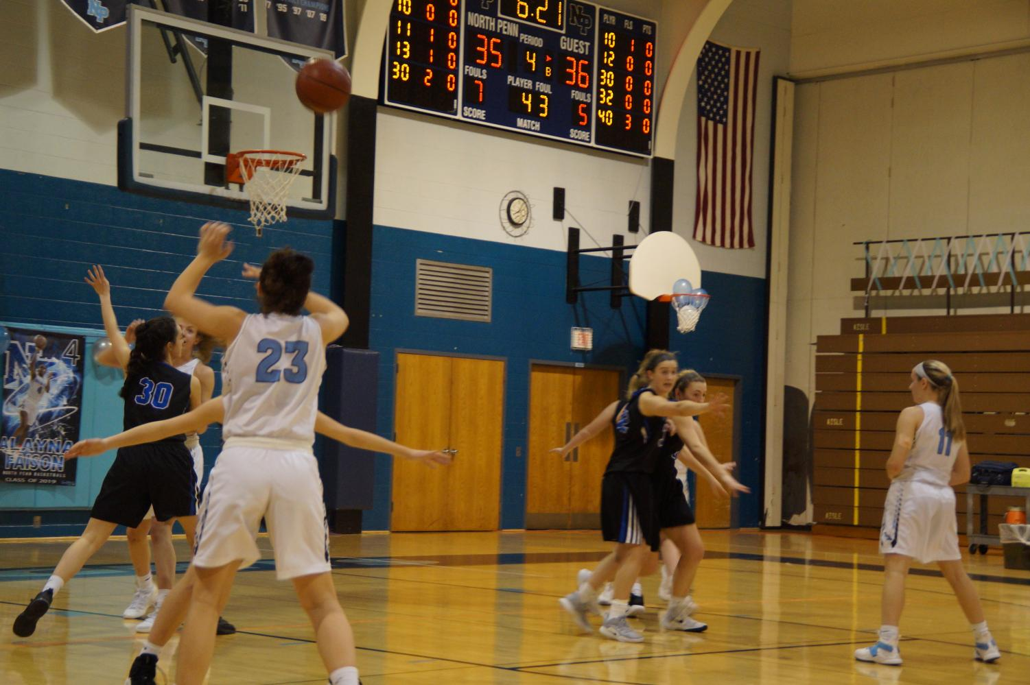 Junior Carley Adams finds senior Cayla Sharkey out of the post for an easy layup.
