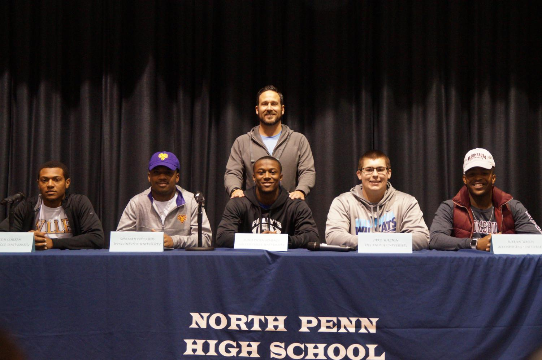Coach David Franek poses with the signees; (from left to right) Kaleem Corbin, Shamar Edwards, Jon Haynes, Jake Walton, and Julian White.