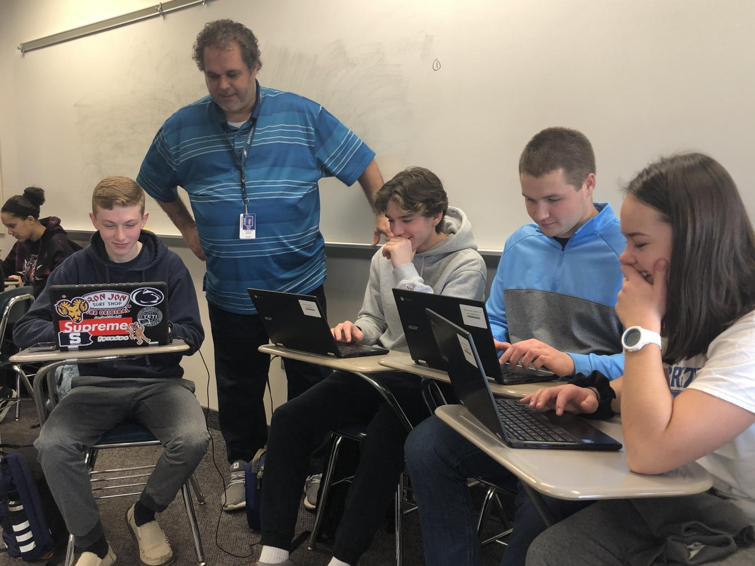 Dr. Dave Hall works with a group of students during a recent class period at NPHS.
