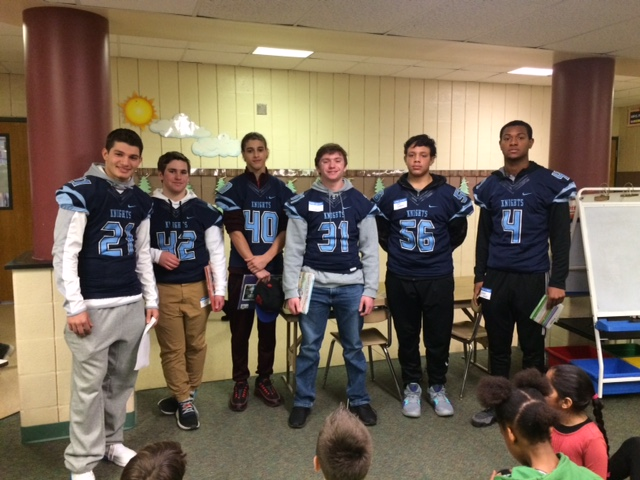 The North Penn Knights pose for a picture at Gwynedd Square Elementary, one of the 13 schools where they read to elementary schoolers for the 15th year in a row.