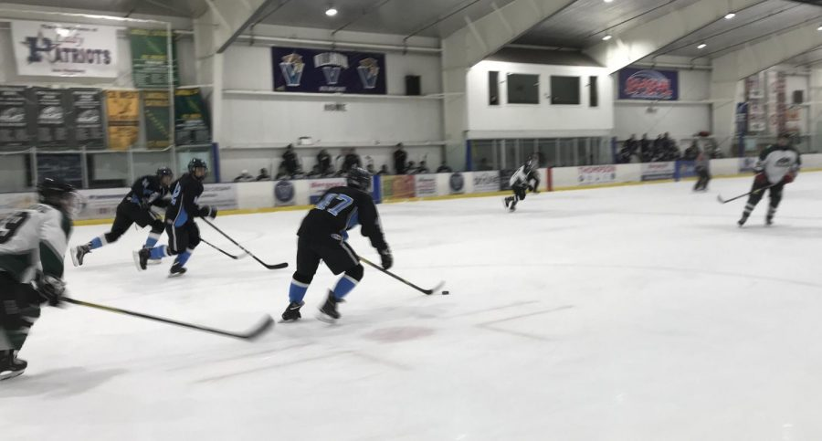 Tyler Greenstein pushes the puck forward to begin an offensive push