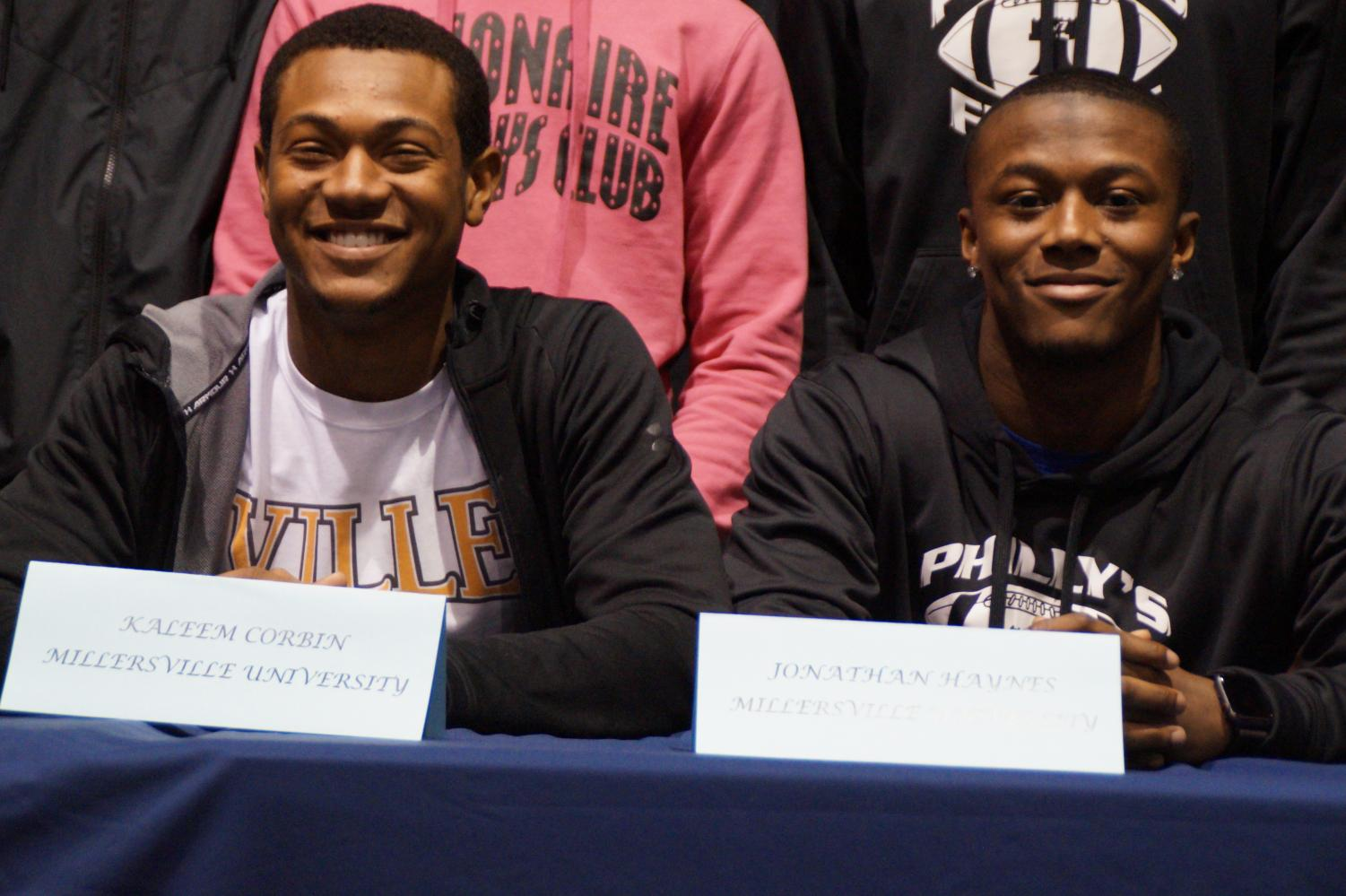 Corbin (left) and Haynes (right) at their signing day where they signed their letters of intent to play football at Millersville University.