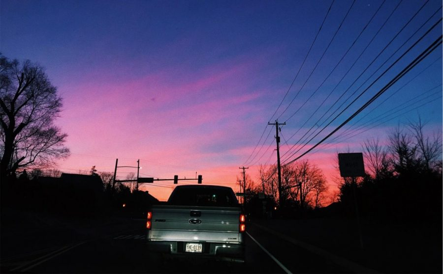 Beautiful pink streaks coat the sky on a typical weekday driving to school.
