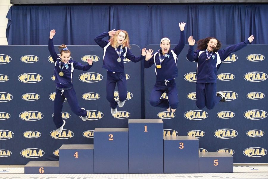 The North Penn divers jump for joy after a dominant showing at states.  From left to right: Maddie Freece, Meghan Wenzel, Paige Burrell, and Kianna Yancey.