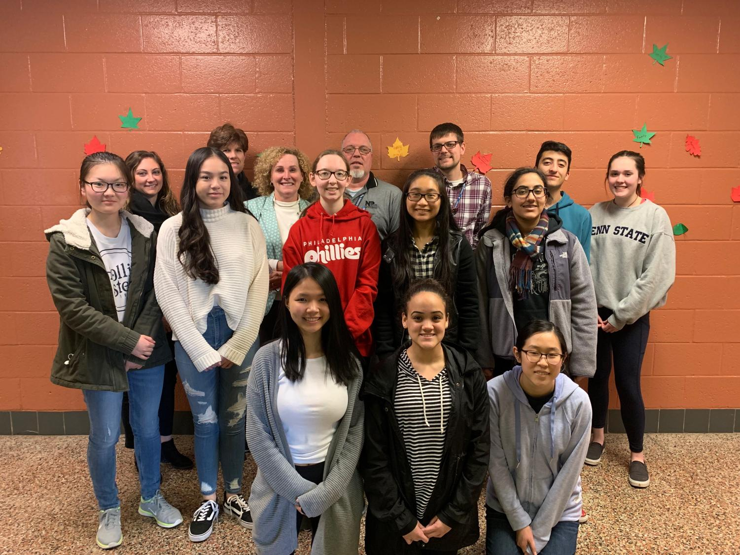 Members of the Enact Club pose for a picture after their meeting with North Penn administration about reducing waste in the school cafeteria.