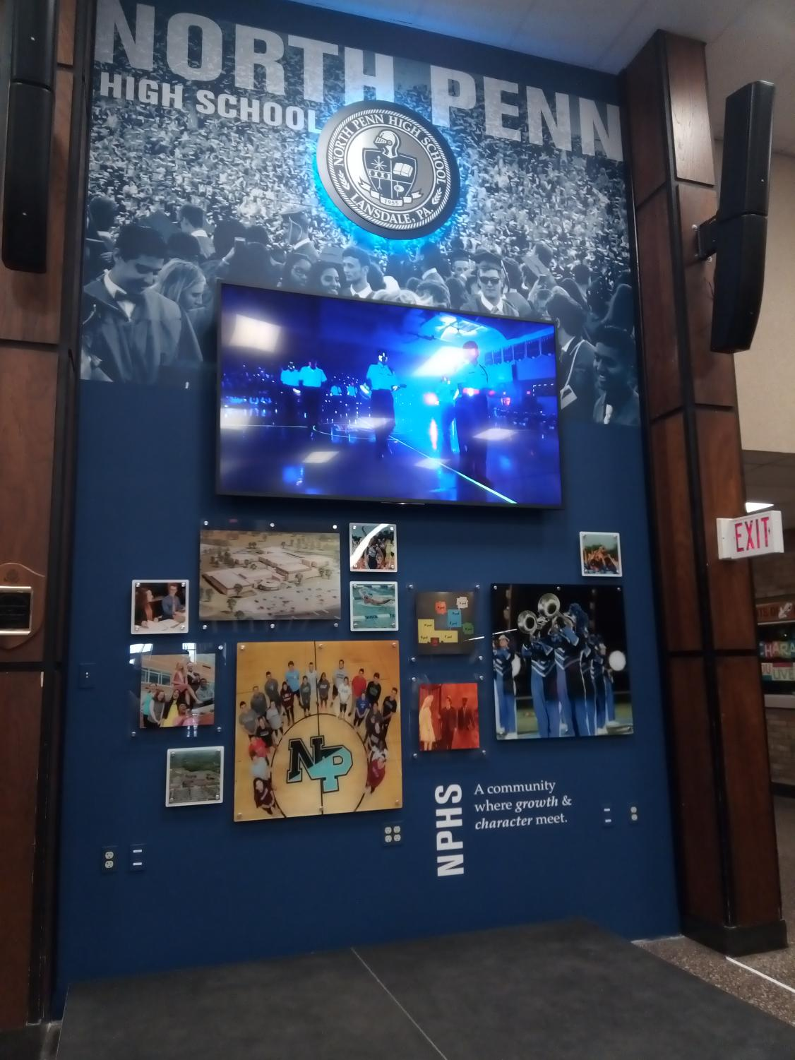 After removing the map in the front lobby, North Penn administration has replaced the wall with a TV, speakers, and moving picture frames to increase the focus on student life.