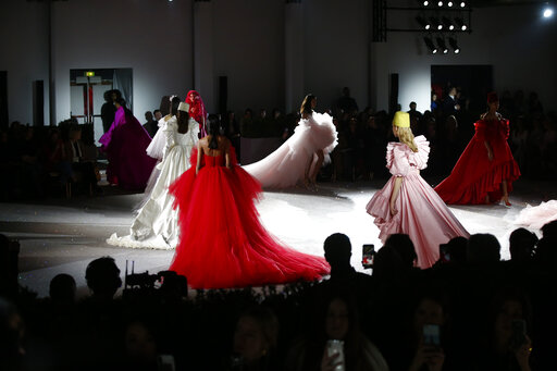 Models wear creations for the Giambattista Valli Spring/Summer 2019 Haute Couture fashion collection presented in Paris, Monday Jan. 21, 2019. (AP Photo/Michel Euler)