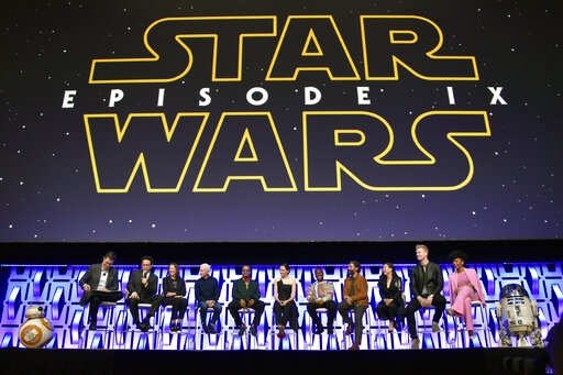 Stephen Colbert, from left, J.J. Abrams, Kathleen Kennedy, Anthony Daniels, Billy Dee Williams, Daisy Ridley, John Boyega, Oscar Isaac, Kelly Marie Tran, Joonas Suotamo and Naomi Ackie participate in the