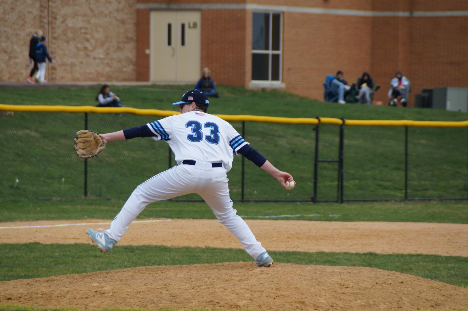 Senior Josh Lowe delivers a pitch as he picked up the win for the Knights.