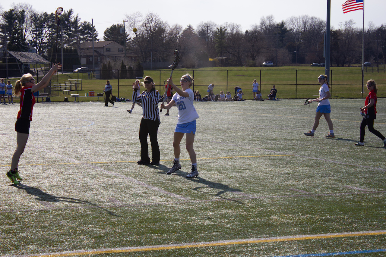 Junior Alaina Mullaly throws the ball forward after winning it over on defense.