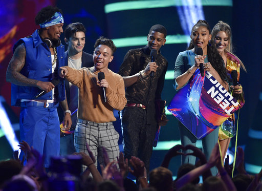 Hosts Nick Cannon, left, and Lele Pons, right, present the award for choice breakout TV for the show to, from second left, Diego Tinoco, Jason Genao, Brett Gray and Sierra Capri for
