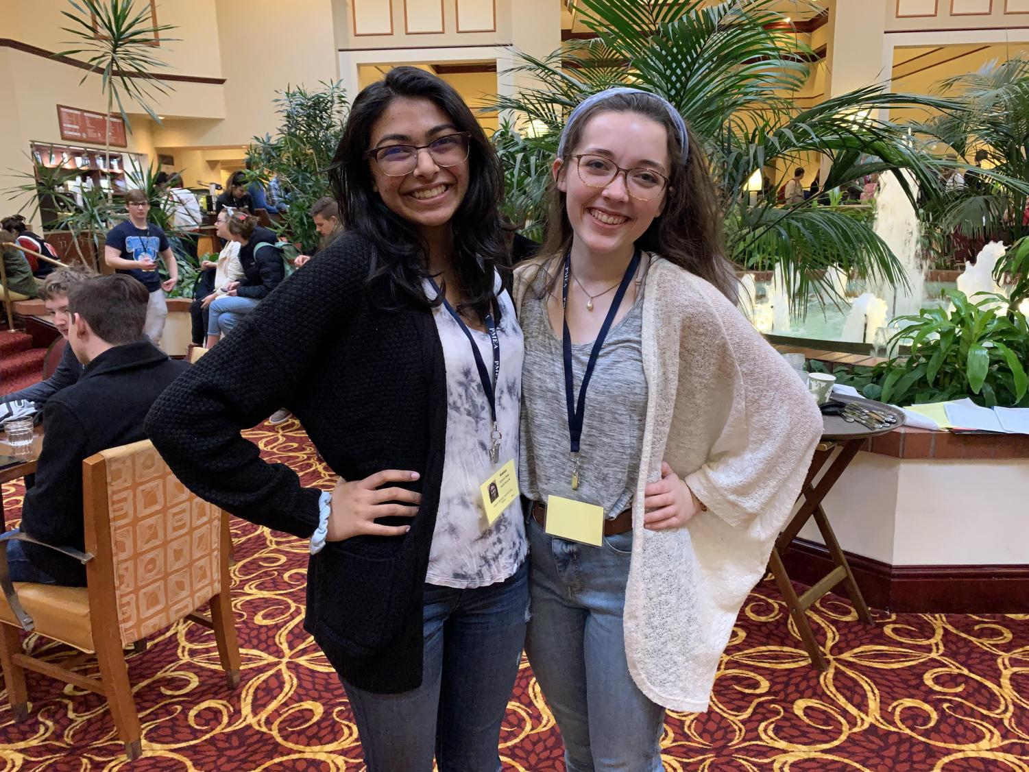 Senior Maddy Burk and junior Kaavya Desai smile for their first day of the PMEA All-State Festival.