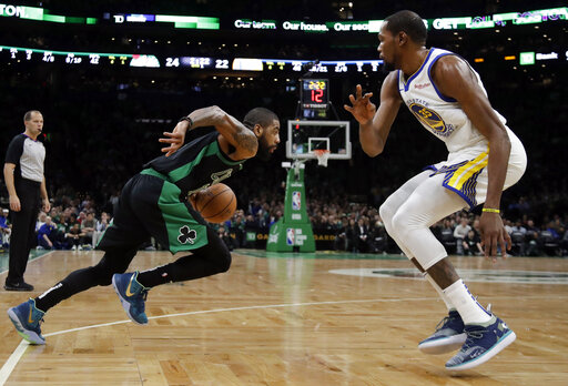 Boston Celtics guard Kyrie Irving (11) drives against Golden State Warriors forward Kevin Durant, right, in the first quarter of an NBA basketball game, Saturday, Jan. 26, 2019, in Boston. (AP Photo/Elise Amendola)