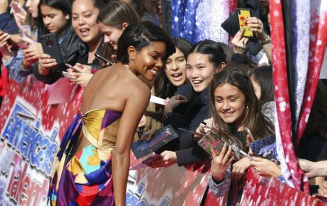 Gabrielle Union takes selfies with the fans as she arrives at the