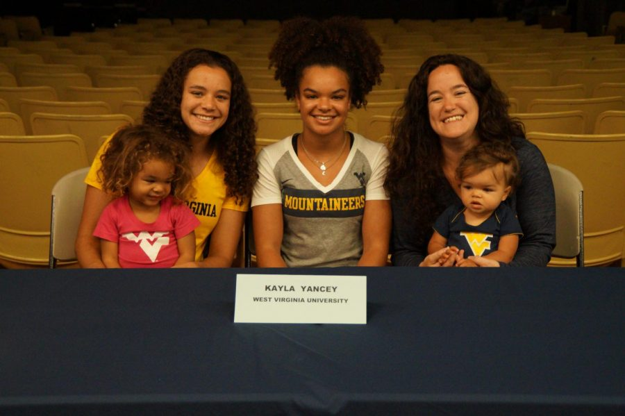 The Yancey family poses for a picture at Kayla's signing of her national letter of intent.