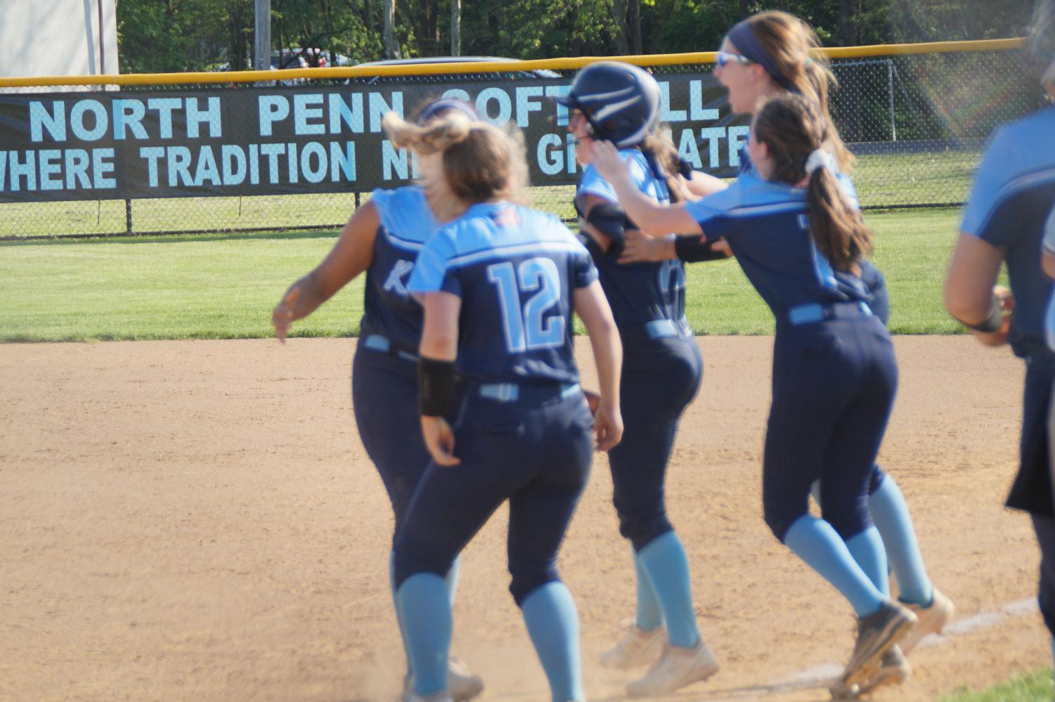 The Knights celebrate with Jordan Pietrzykoski after her walk-off hit.