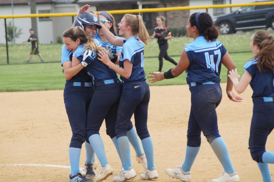 The+Knights+celebrate+around+Carley+DiGiuseppe+after+her+walk-off+hit.