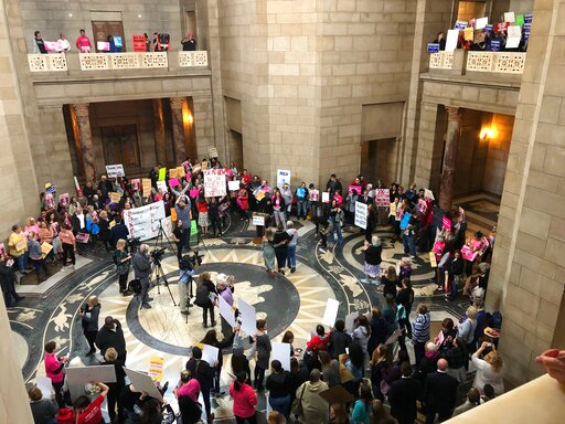 Supporters of abortion rights rally against recently passed restrictions on abortions in the Statehouse rotunda Tuesday, May 21, 2019, at the Nebraska Capitol in Lincoln, Nebraska. More than 350 people filled the Capitol as part of a national campaign to build momentum for their cause in the 2020 election. (AP Photo/Grant Schulte)