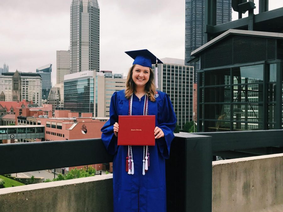 Rebecca Marshall captured smiling ear to ear with her diploma from Duquesne University.