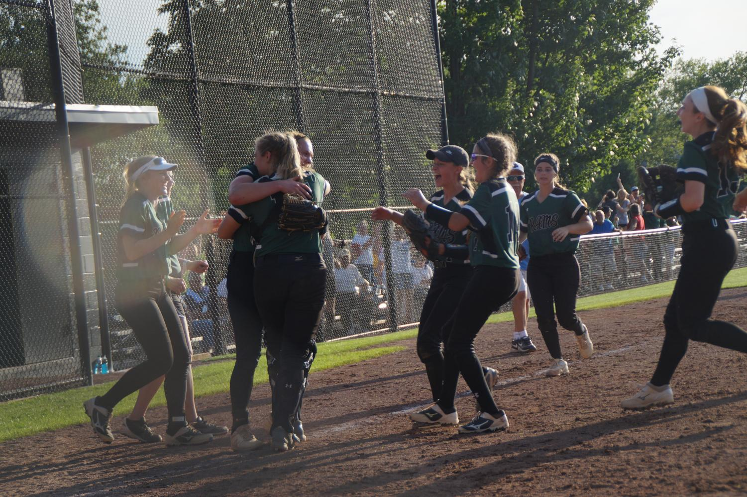 The Rams celebrate after their extra inning victory