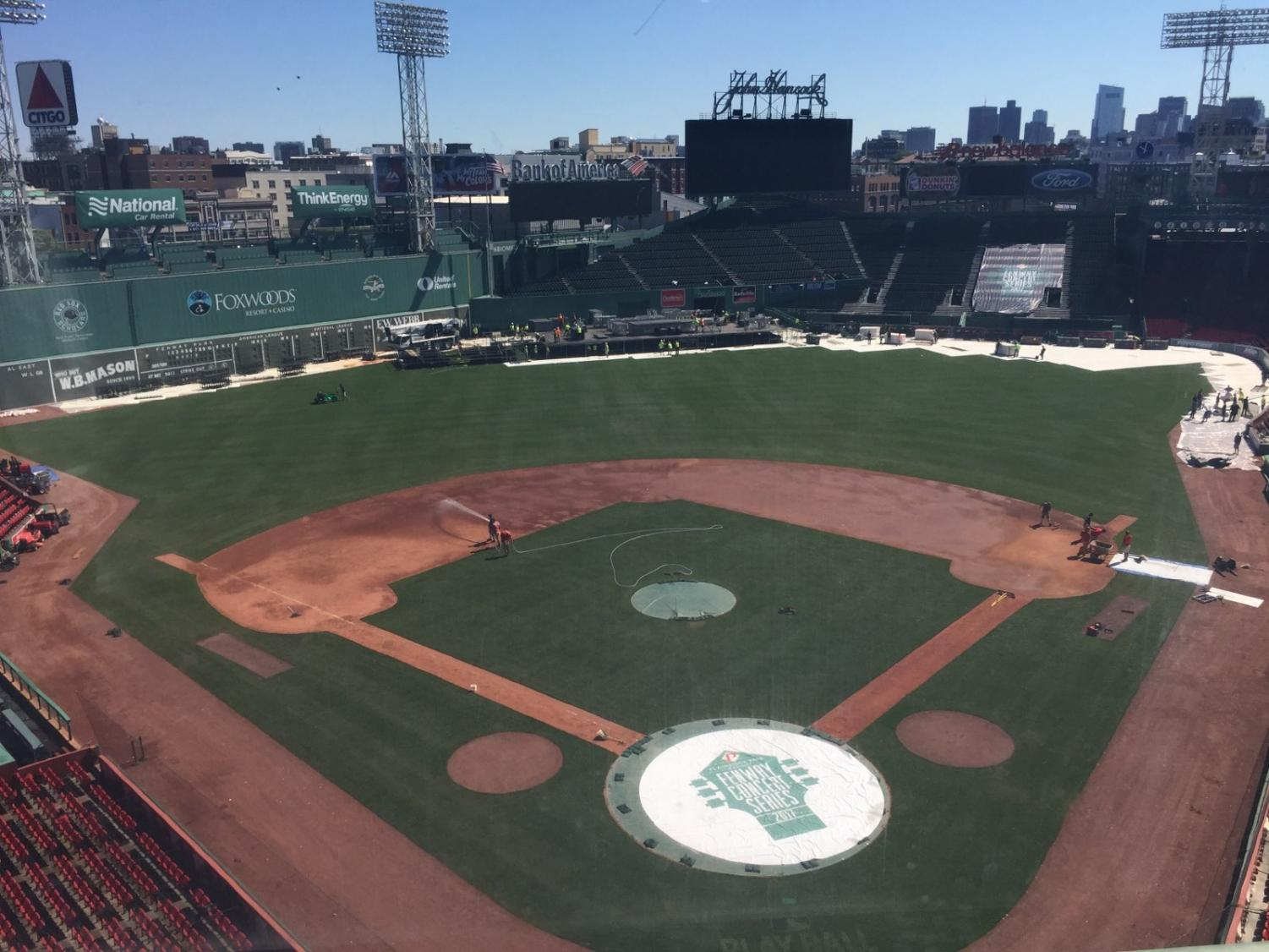 Workers at Fenway Park tearing down a stage the morning after a Paula Abdul/Boyz II Men/New Kids on the Block concert.
