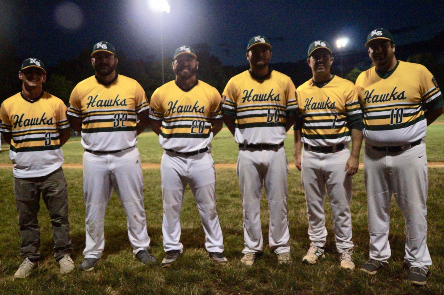 The Hawks coaching staff (from left to right: Coach Yac, Coach Smink, Coach Cameron, Coach Billetz, Coach Bart, and Coach Bertucci) pose for a picture after a 3-2 extra inning victory over Hatfield-Towamencin.
