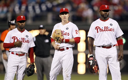 Philadelphia Phillies' from th eleft, Jimmy Rollins, Chase Utley, and Ryan Howard during  a baseball game against the Miami Marlins, Friday, April 11, 2014, in Philadelphia. (AP Photo/Tom Mihalek)