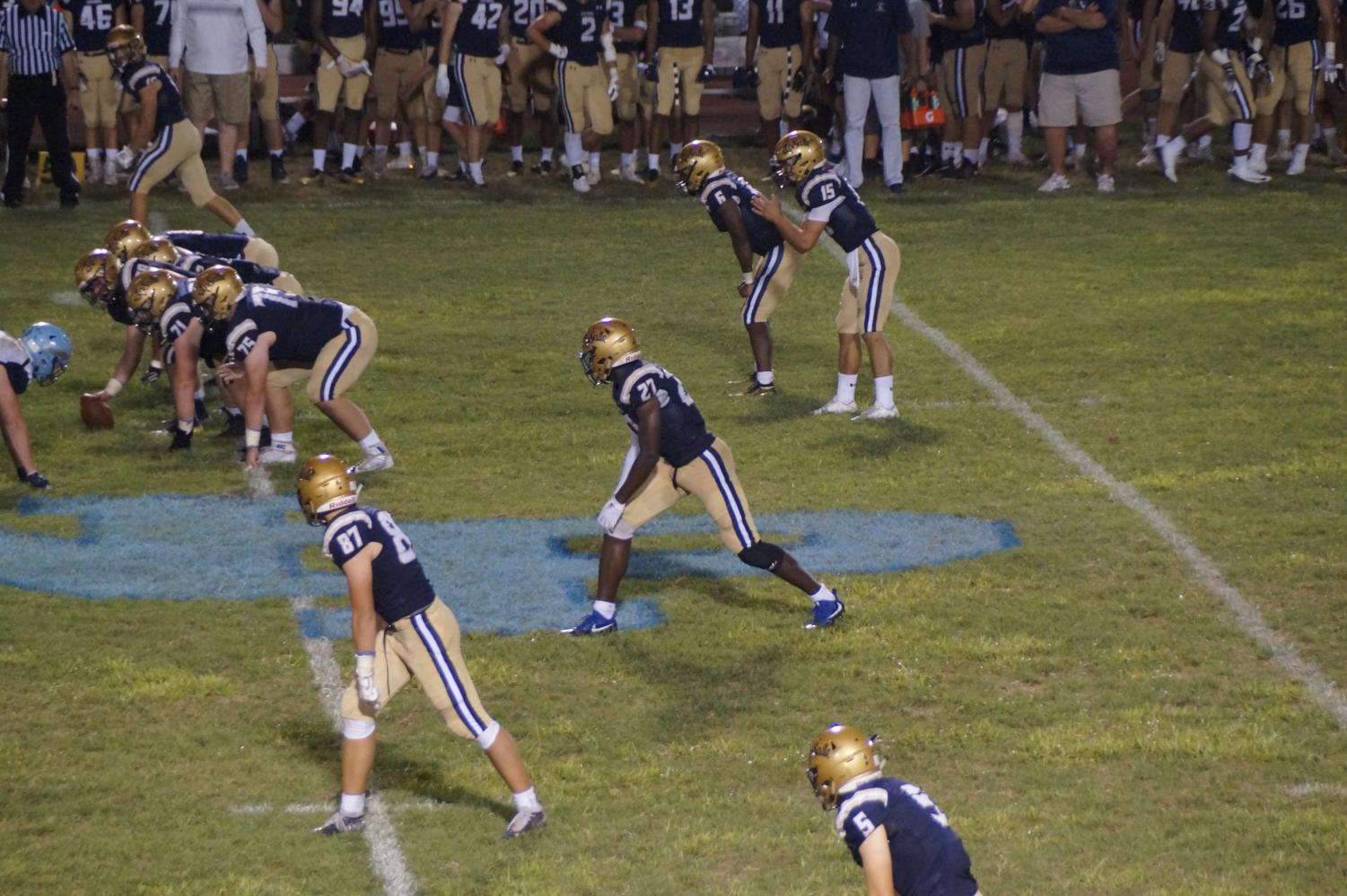 Jack Machita in the shotgun formation with #27 Samuel Brown lined up ready to go out for a pass.  Brown ended the game with 5 touchdowns.