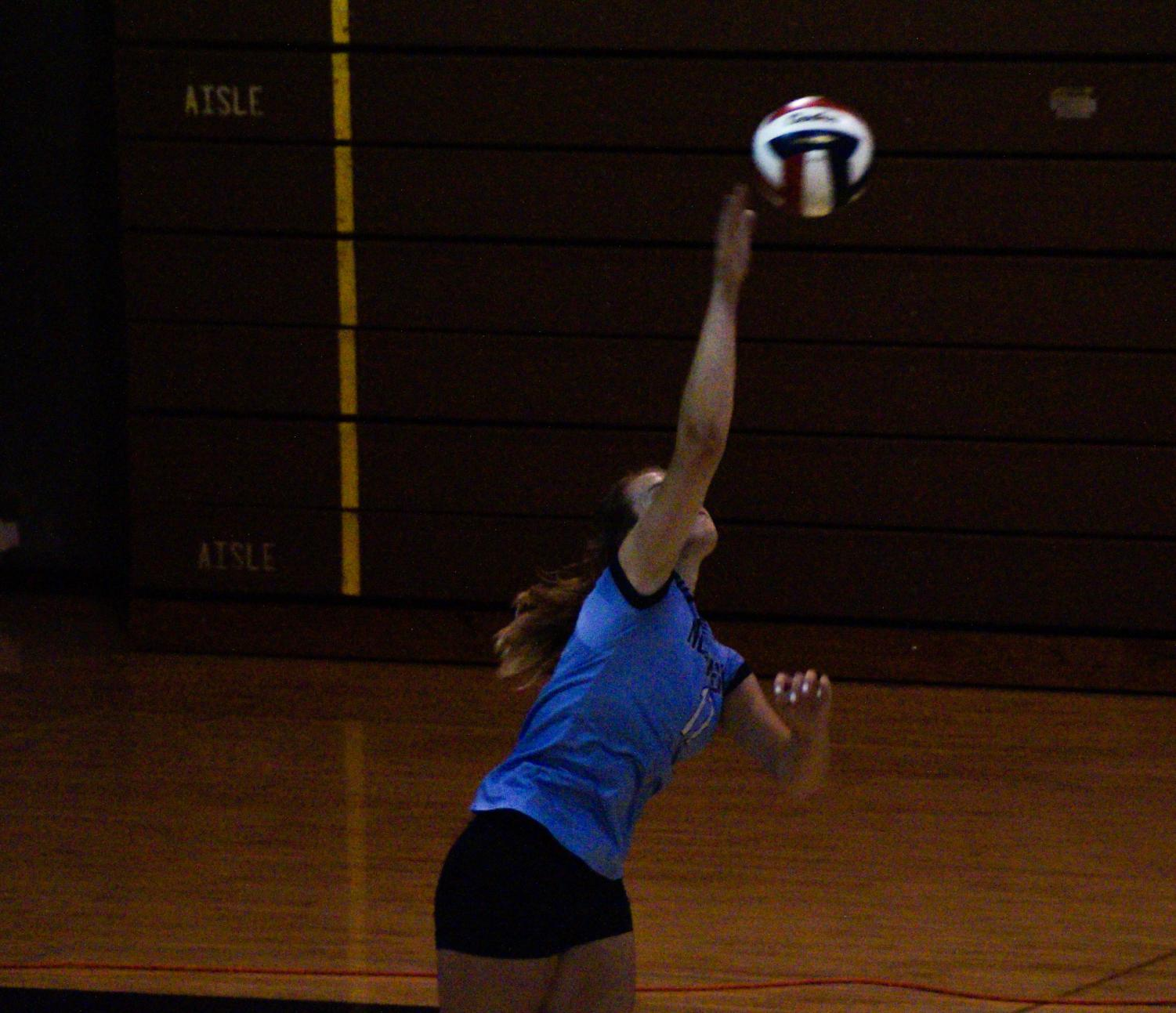 Captain, Natalie Wernly, serves the ball for North Penn.