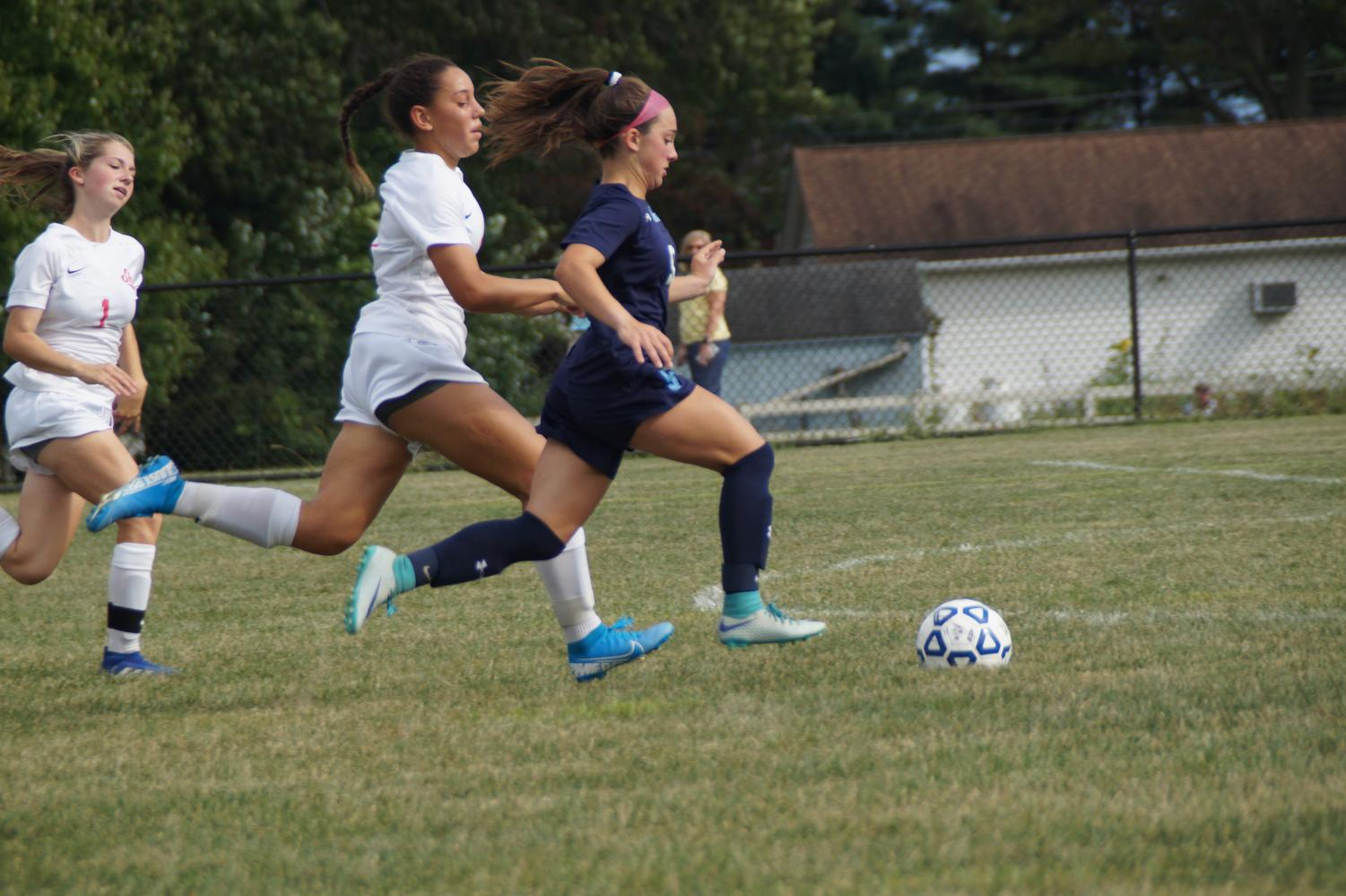 Emily Varilla dribbles past the Redskins defense to score a goal.