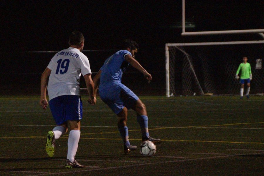 Ryan+Stewart+dribbles+with+the+ball.+The+senior+had+an+assist+in+the+game.
