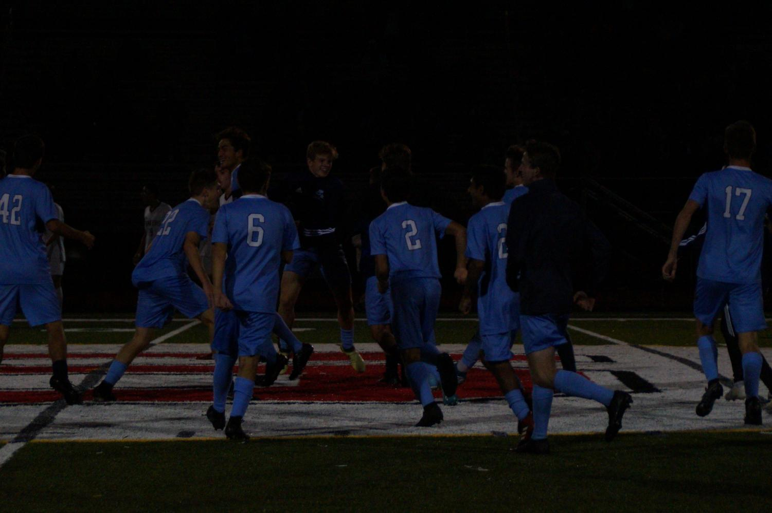 The Knights celebrate after their win that sent them into the District Final