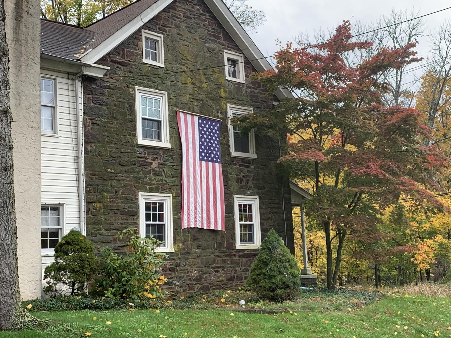 AUTUMN AMERICANA -  A home at the intersection of Old Morris Rd. and Old Forty Foot Rd. in Towamencin Township displays the American flag on October 30, 2019. If it's autumn and it's America, that means it's also election season. Tuesday, Novmeber 5th voters across the country will make choices, largely in local elections, as they exercise their civil duty and cast their votes.